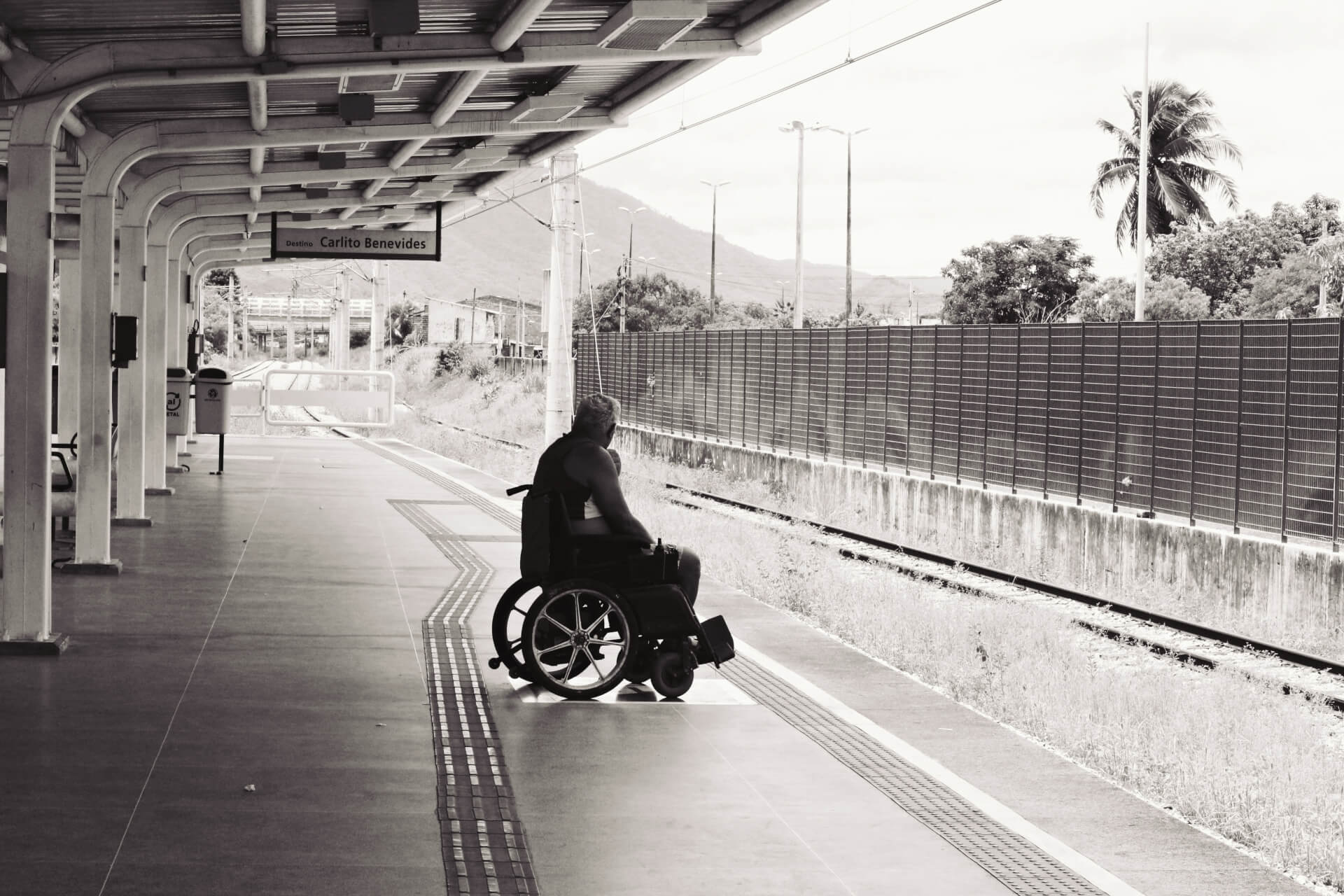 Photo by igor Rodrigues. Man in Wheelchair
